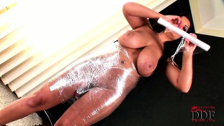 She wraps herself in cellophane and does some really sexy posing