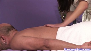 Sexy oriental hottie gives a sweet body massage till his cock pops up