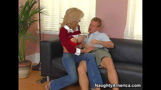 Slutty and arousing blonde mom in jeans enjoys in sucking and licking a hard bazooka on the couch in her living room and enjoys in giving head for the cam