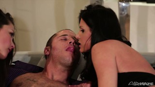 A duo of hot brunettes take turns tending to his massive cock