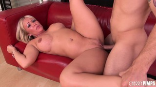 He pounds her on the couch and turns her over to nail her doggy style