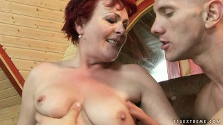 Brunette granny makes out and they trade some head on the couch