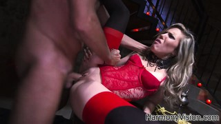 Hot blonde in red lingerie lies on the table and surrenders her cunt to a big cock
