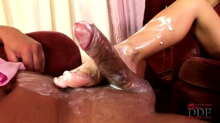 She spreads cream on her cute feet to lube up his hard fat cock