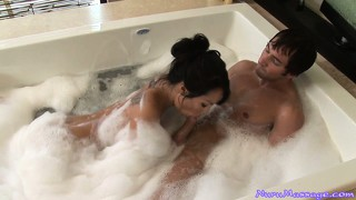 Sexy asian babe with tattoos joins him in the hot bubble bath