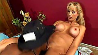 Good looking mature blonde cougar with big fake tits and long legs gets her trimmed minge licked good and boned deep by horny black dude while her husband is at work