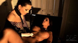 Wearing fishnet sleeves and rubber gloves, she gives an enema that spews