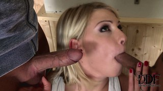 Horny blonde bitch takes on two cocks and blows them both in a threesome