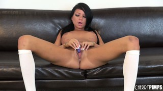 Raven bay lounges on her black sofa frigging her bean and moaning