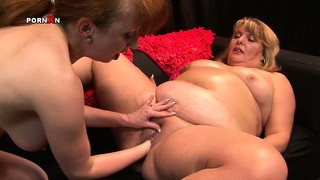 Huge fat milf gets her snatch worked out with a horny dyke's fist