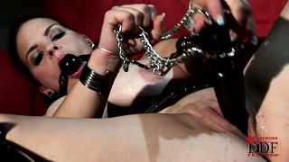 Busty brunette goes for the ball gag and big dildo in this solo action