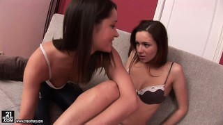 Two dazzling brunettes strip each other's clothes exposing their sexy slim bodies