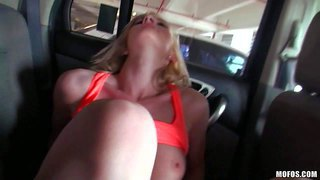 Young long haired blonde slut with firm natural boobs and tight ass in orange sports bra gives memorable blowjob to her lover in the car while he films her in pov