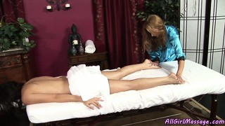 Lesbian masseuse rubs her up and then goes right for her bald slit