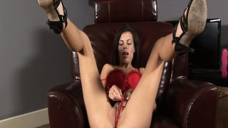 Carmela reveals the sexy contours of her body while drilling her holes with a dildo
