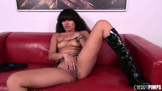Annie cruz plays with herself wearing a belt and kinky high boots