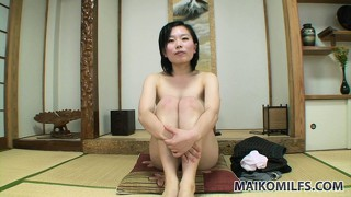 Naughty japanese broad exposes her thick black bush at the dojo