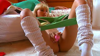 Gentle lesbian babe penetrates her shaved pussy with a toy