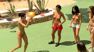 A group of hot chicks plays volleyball nude