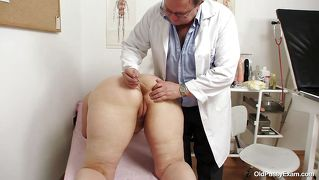 Chubby blonde getting her mature vagina examined