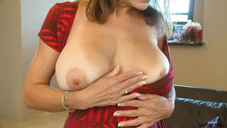 Busty mom has a dildo