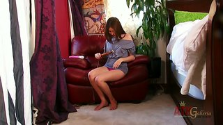 Shyla jennings plays with the dildo in big armchair