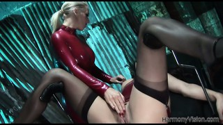 In their sexy latex suits, two marvelous babes please each other's wet pussies