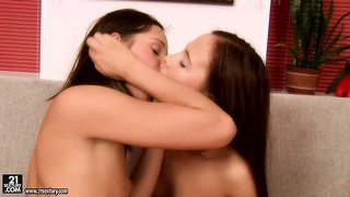 Yummy brunette sticks two long vibrators in the butt of her friend