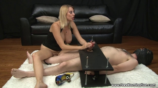 Mean dominant milf uses helpless slave during handjob