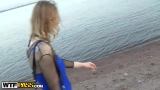Girl in fishnets blowing