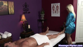 Sexy blonde masseuse rubs him down and grabs his thorny prick