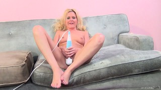 Sexy blonde with perky tits kelly lies on the couch and has a guy fingering her cunt