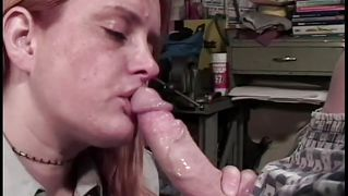 Chubby redhead gives a blowjob
