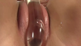 Meaty lipped babe fills pussy with dildo