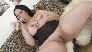 Chubby brunette mature plays with her huge boobs and shaved cunt