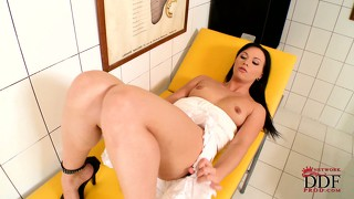 This dirty dark haired whore can't resist rubbing her fanny when left alone