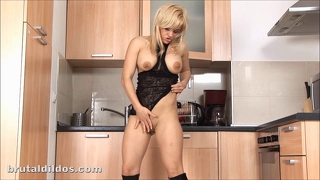 Busty blonde squirting from big red dildo