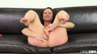 She toys legs spread wide and then grabs her vibrator for more