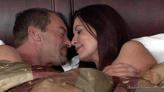 Magdalene st michaels is sex hungry in her 50-something. this dark haired experienced woman with charming smile turns on randy spears in bed. they kiss and he touches her body.