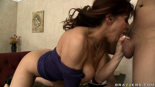 Redheaded cougar in a blue dress gets spit roasted by two guys