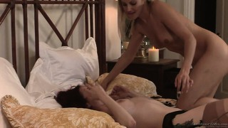 Blonde sits on her face and then they do some tribbing before kissing