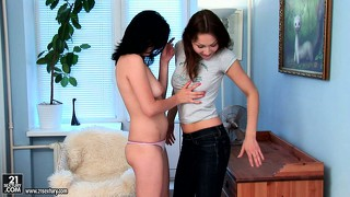 Sexy brunette lesbians kiss and lick, and then bring out the dildo to fuck