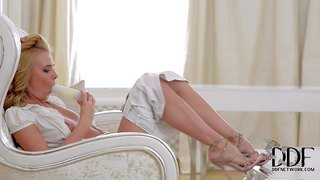 Ema is a sweet russian blonde dressed in white. she unbuttons her blouse and bares her small perky tits before she parts her legs and fucks her european pussy with dildo. watch attractive lady masturbate.