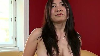 Asian milf with big boobs came to a casting and is touching her shaved pussy