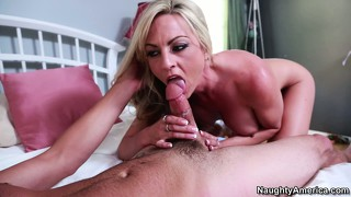 Sindy lange pushes him back on her bed and sucks his cock hard