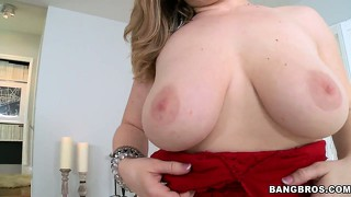 Wonderful blonde drops her red shirt and her pants revealing her huge tits and sexy ass