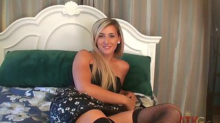 Lilly banks poses in stockings and dress
