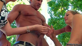 Destiny porter and her friend lizzy london enjoy in sharing the same hard rod in a hot and arousing threesome with a muscled hunk in their garden and have fun