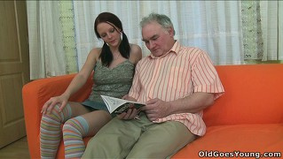 Ilona isn't sure what to do with this horny old man groping her