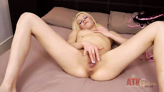 Blonde exotic april paisley with small tits and shaved twat strips naked to give a close-up of her pussy hole in solo scene